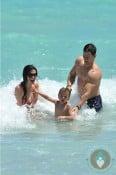 Mark and Michael Wahlberg, Rhea Durham at beach Miami