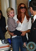 Poppy Montgomery with son Jackson Kaufman at Sydney airport