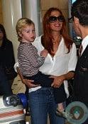 Poppy Montgomery with son Jackson Kaufman at Sydney airport