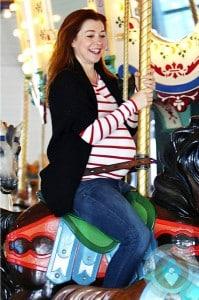 pregnant Alyson Hannigan on the carousel at Santa Monica Pier