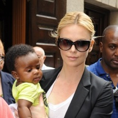 Charlize Steps Out With Her Son Jackson in Madrid
