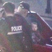 Passersby Reports Toddler Strapped Into Bed of a Pickup Truck
