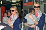 Charlize Theron and son Jackson @ Charles De Gaulle Airport