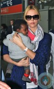 Charlize Theron with son Jackson @ Charles De Gaulle Airport