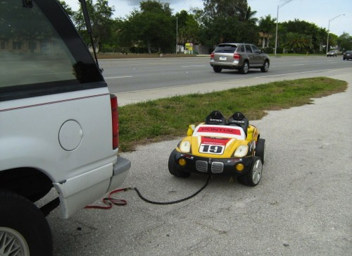Grandparents Paul and Belinda Berloni Arrested For Towing granddaughter behind SUV in toy car 3