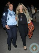 Pregnant Molly Sims Leaving Coldplay concert