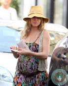 Pregnant Sienna Miller out in London, yoga