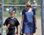 pregnant Reese Witherspoon with son Deacon at football game