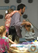 Ben Affleck, Violet Affleck, Seraphina Affleck playing during fashion camp Santa Monica