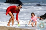 Alessandra Ambrosio, with daughter Anja Mazur at the beach