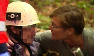 Ina Koenig (left) is pulled from a mine shaft by rescue workers