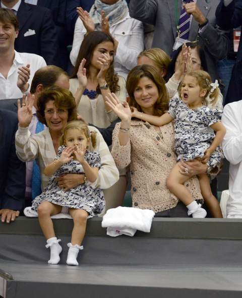 Mirka Federer watches husband Roger Federer with her twin daughters Myla Rose and Charlene Riva