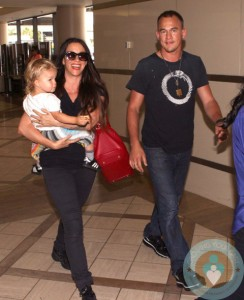 Alanis Morissette with husband Mario Treadway and son Ever LAX