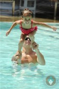 Casper Smart and Emme Anthony in the pool in Miami