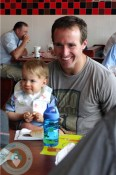 DRew Brees with son Bowen in NOrleans