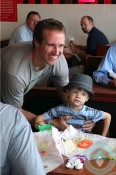 Drew Brees with son Baylen in New Orleans