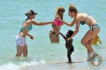 Jillian MIchaels and heidi Rhoades with daughter Lukensia in Miami