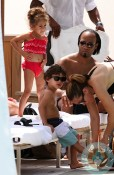 Max and Emme Anthony by the pool in Miami