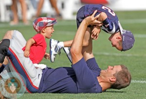Tom Brady with son Benjamin and john at the Patriots training camp