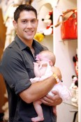 Actor Talon Smith with daughter at the Disney Baby Store Opening