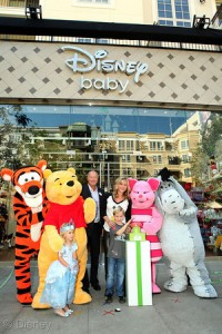 Bob Chapek, actress Allison Sweeney with daughter Megan and son Ben at the Disney Baby Store Opening