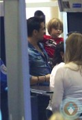 Colin Farrell goes through security with son Henry at LAX
