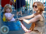 Isla Fisher with daughter Elula at a petting zoo