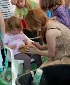 Isla Fisher with daughter Elula at the petting zoo