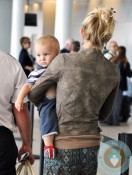 Kate Hudson Carries her son Bingham at Toronto International Airport