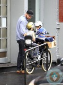 Liev Schreiber rides on a bike with his sons Sammy & Sasha