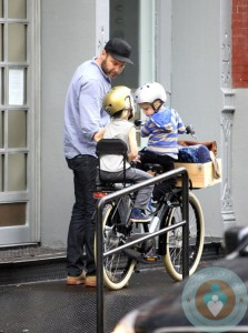 Liev Schreiber rides on a bike with his sons Sammy & Sasha