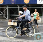 Liev Schreiber rides on a bike with his sons Sammy and Sasha