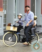 Liev Schreiber rides on a bike with his sons Sammy and Sasha in NYC