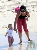 Pink (Alecia Moore) with daughter Willow at the beach.