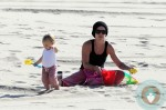 Pink plays with her daughter Willow at the beach
