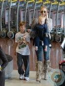 Kate Hudson & Kids Touch Down In Paris
