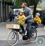 Liev Schreiber bikes through NYC with Samuel and Sasha