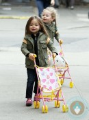 Marion and Tabitha Broderick push their strollers through the city