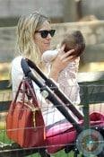 Sienna Miller cuddles daughter Marlowe in Central park