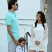 Kourtney Kardashian and Scott Disick Play Poolside With Mason