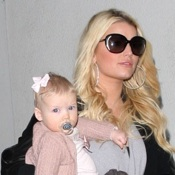 Jessica Simpson & Her Family Touch Down At LAX