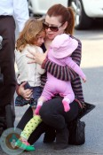 Alyson Hannigan has her hands full as she takes her daughters Satyana and Keeva out for lunch in Los Angeles