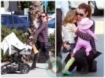 Alyson Hannigan juggles her daughters Keeva and Satyana in LA