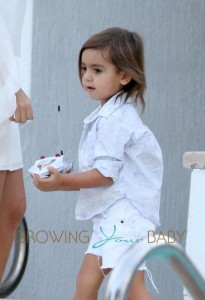 Kourtney Kardashian and Scott Disick Have Poolside Fun With Mason