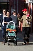 Neve Campbell and partner J.J. Feild take their baby boy Caspian out for a stroll in LA