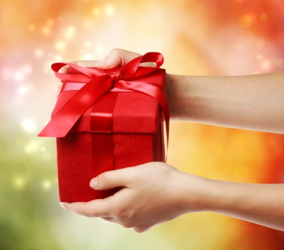 woman giving a gift