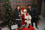 Ali Landry, husband Alejandro Monteverde, Estella, Marcelo pose with Santa - Photographer Noah Graham