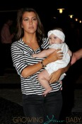 Kourtney Kardashian holds daughter Penelope close as she heads into Serendipity's in Miami to celebrate her son Mason's third birthday