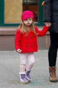 Jessica Parker's twin daughters Tabitha and Loretta Broderick wear colorful coats as they walk to school with their babysitter