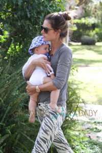 Alessandra Ambrosio holds her son Noah Mazur close, as they make a quick stop at the Brentwood Country Mart in Los Angeles